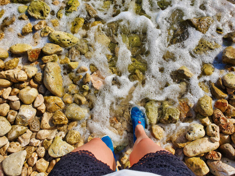 Elke wearing water shoes and standing in the Adriatic Sea