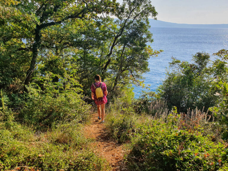 Elke walking close to the sea on the hiking trail from Novi Vinodolski to Selce
