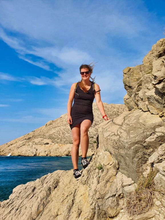 Elke standing on the rocks at Oprna Bay beach