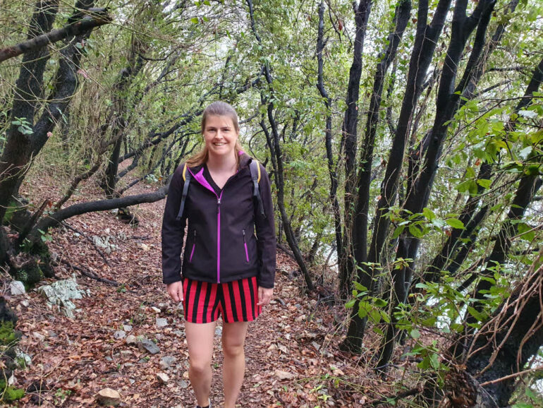 Elke hiking through the black trees of Duga Luka
