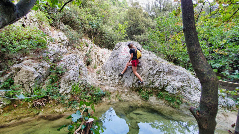 Climbing over a small lake close to Rabac