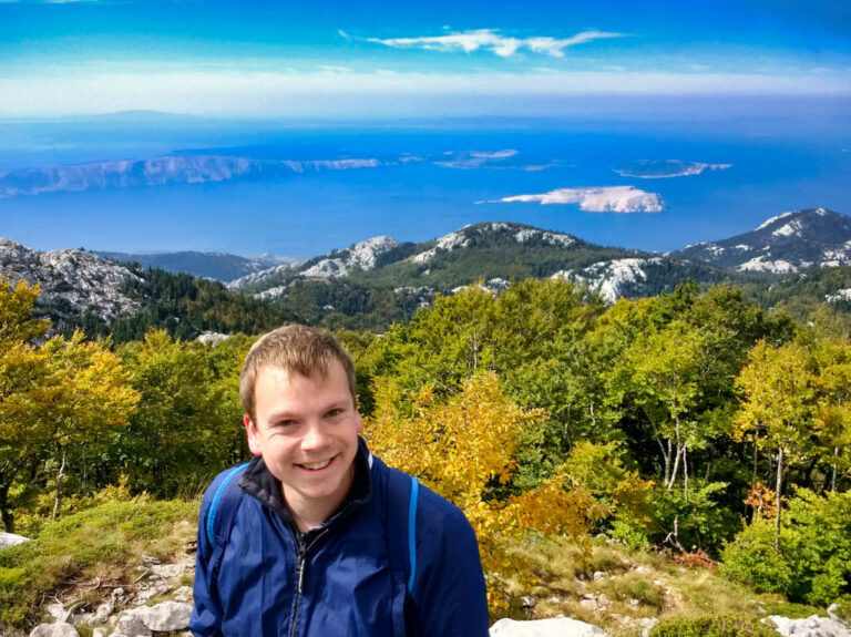 Steven and a view on the Adriatic Sea from Zavizan Mountain in Northern Velebit National Park