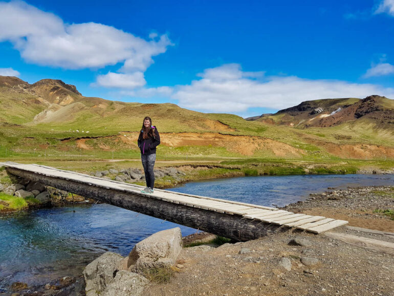 Wooden bridge across the river at the start of the trail to the Reykjadalur Valley