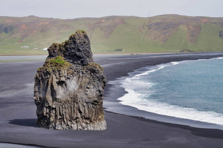 Arnardrangur basalt stack on the black sand beach Reynisfjara