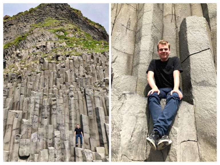 Steven sitting on basalt columns at Reynisdrangar beach