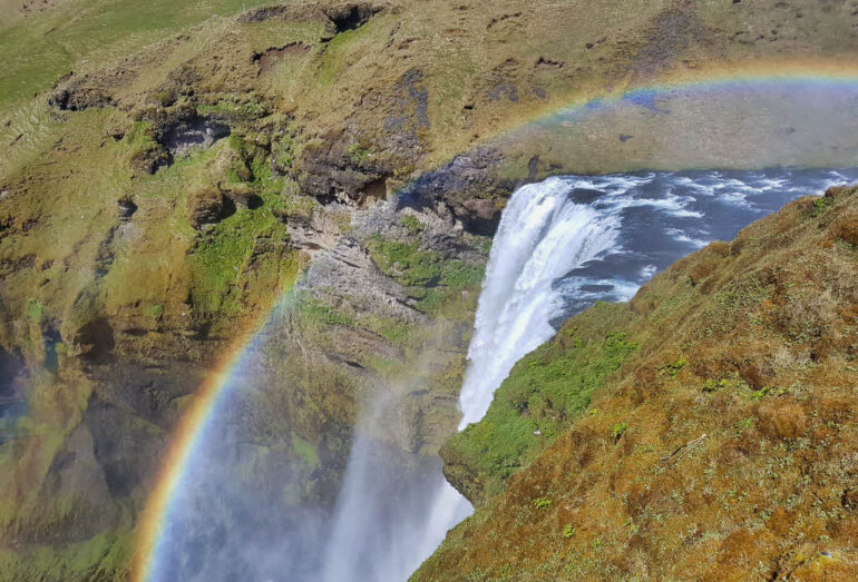 Rainbow at the top of the Skógafoss waterfall in Iceland