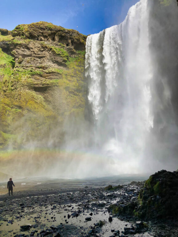 Rainbow at the foot of the Skógafoss waterfall in Iceland