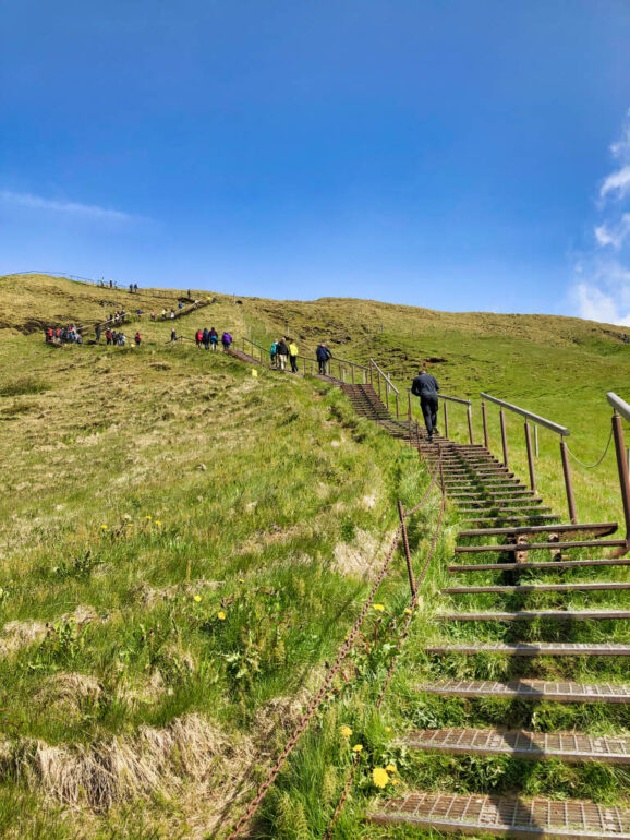 Stairs on grass of mountain